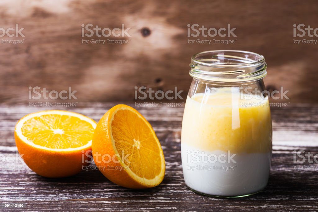 Delicious homemade organic orange smoothie in a glass jar stock photo