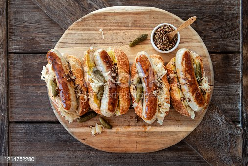 Delicious pork sausage hot dogs with sauerkraut and mustard