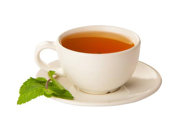 delicious hot green tea on white - theekop stockfoto's en -beelden