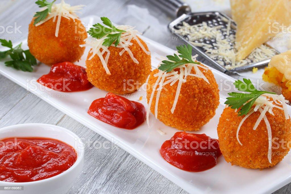 delicious hot italian arancini on plate stock photo