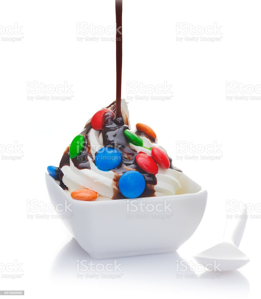Delicious ice cream topped with pouring chocolate stock photo