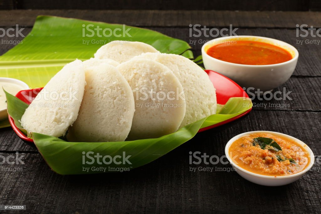 Delicious idli served with chutney and sambar stock photo