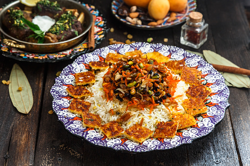 istock Delicious Iranian jewelled rice topped with nuts, raisins and orange zest 932450790