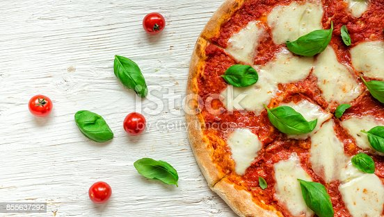 istock Delicious italian pizza served on wooden table 855637292
