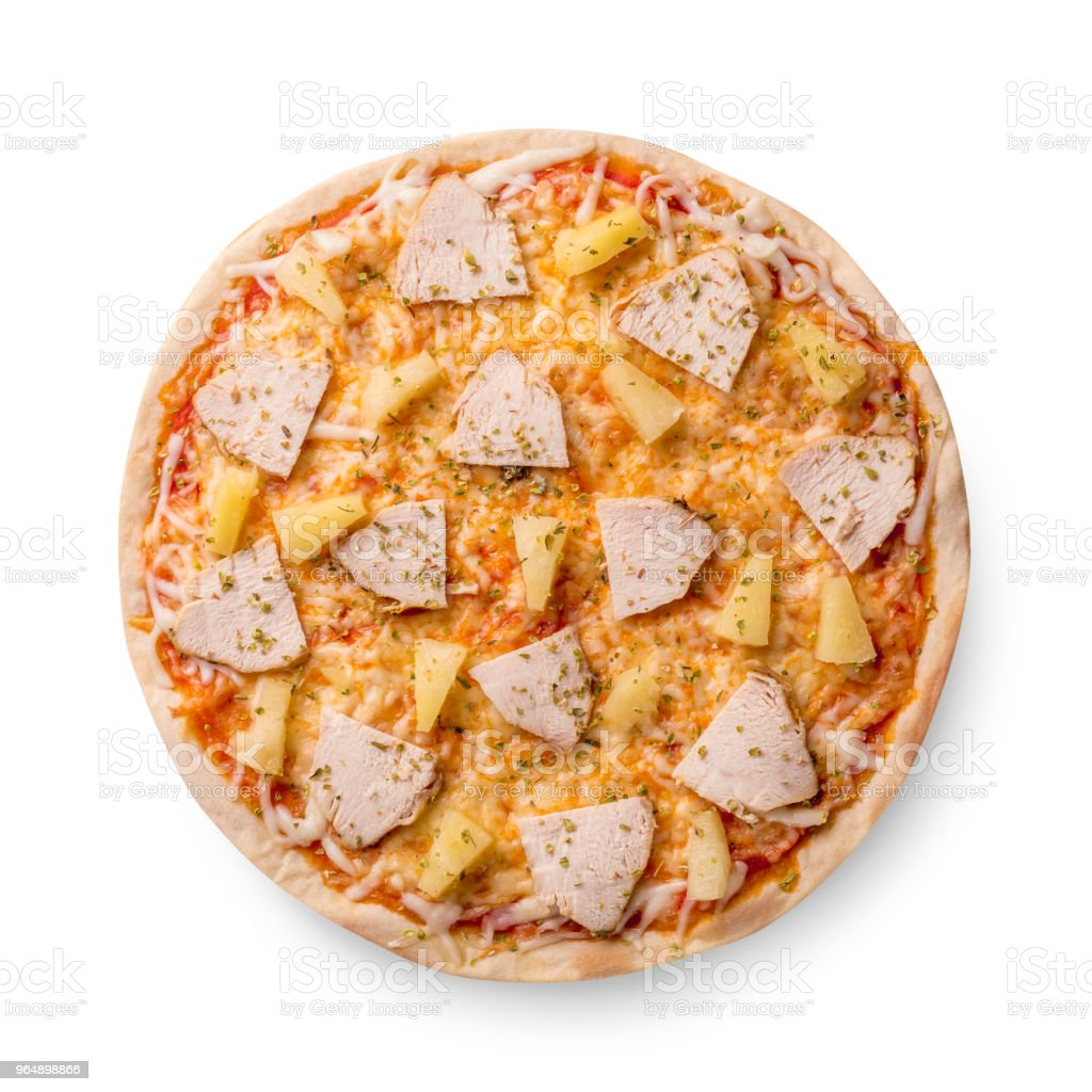 Delicious italian pizza with pineapples and chicken fillet isolated on white background. Top view royalty-free stock photo