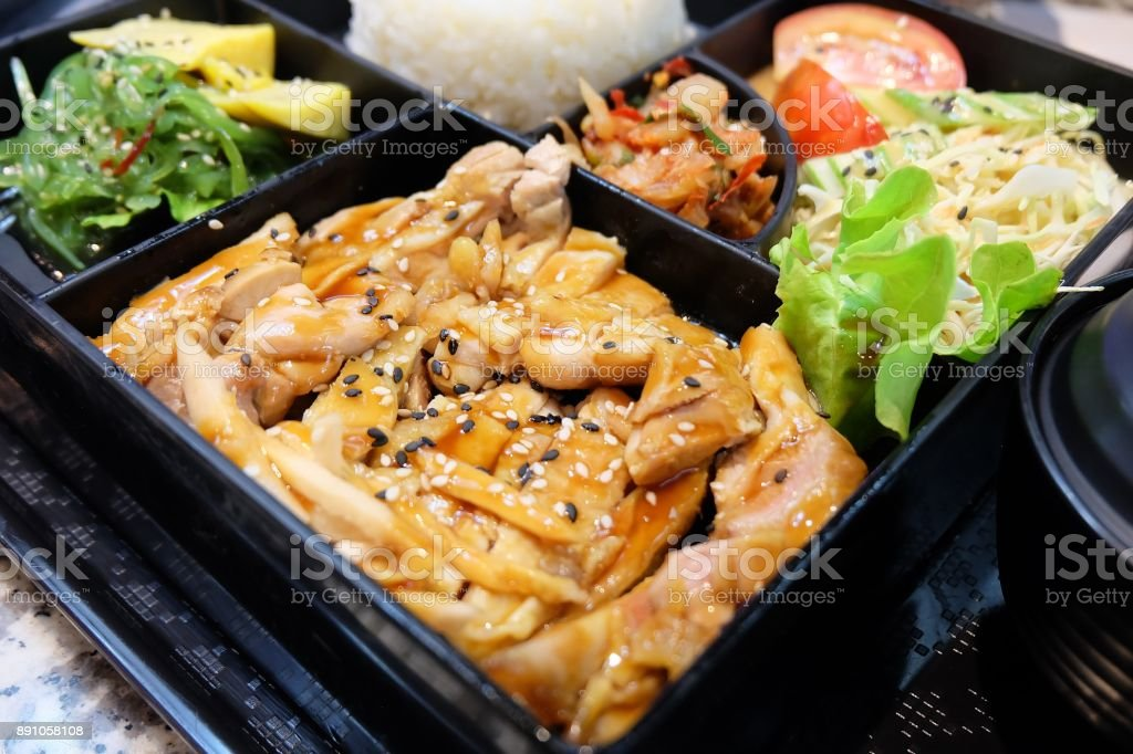 Delicious Japanese Bento Box with Teriyaki Chicken stock photo