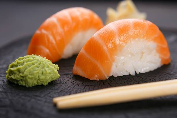Delicious Japanese cuisine, nigiri sushi with salmon served with stock photo