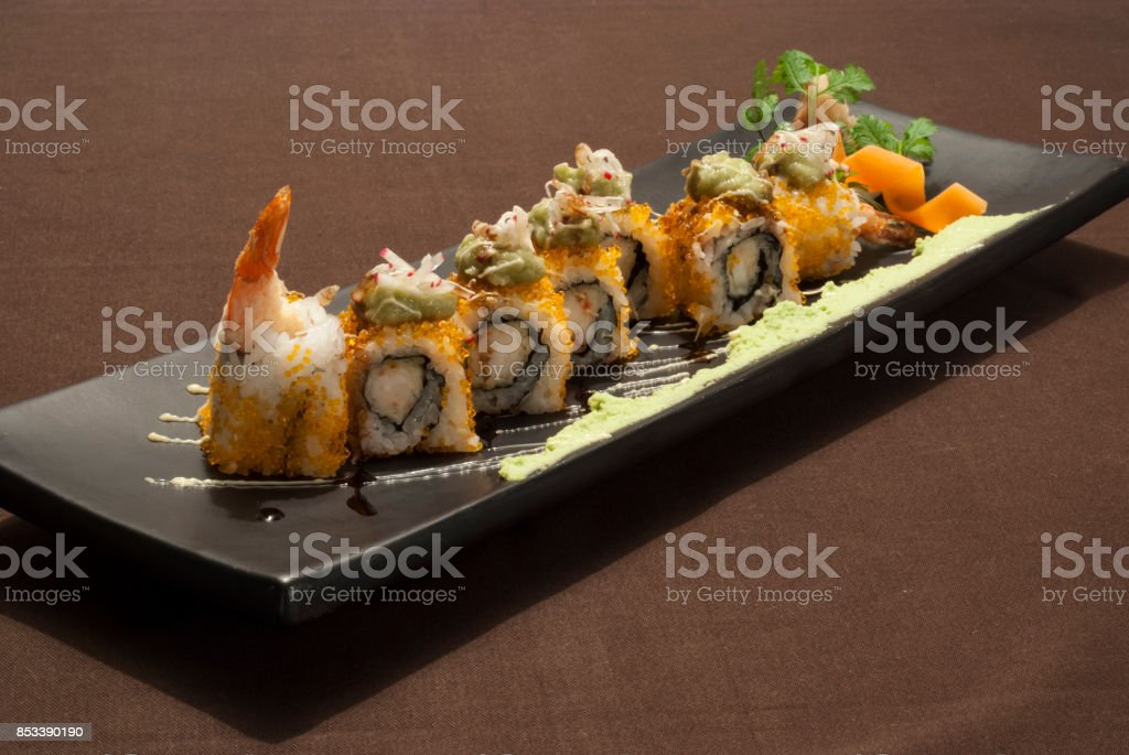 Delicious japanese fusion food with shrimp on a black plate stock photo