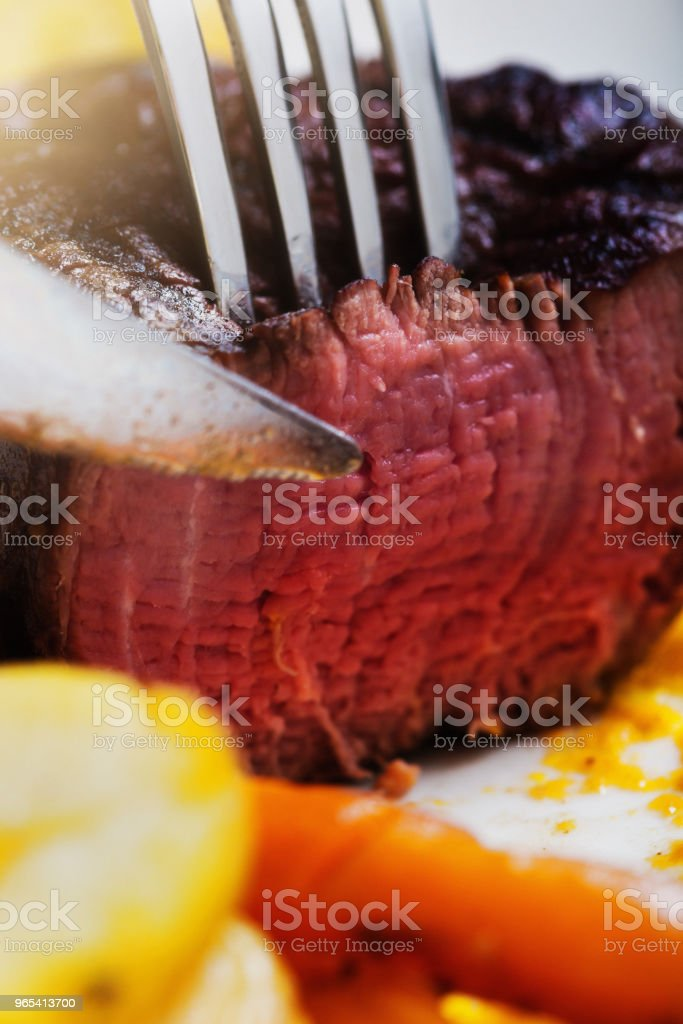 Delicious, juicy fillet steak being sliced in close-up royalty-free stock photo