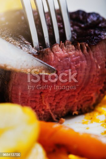 Delicious Juicy Fillet Steak Being Sliced In Closeup Stock Photo & More Pictures of Beef
