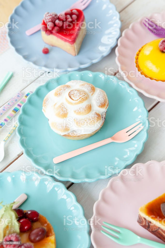Delicious little cakes and pies on colorful plates