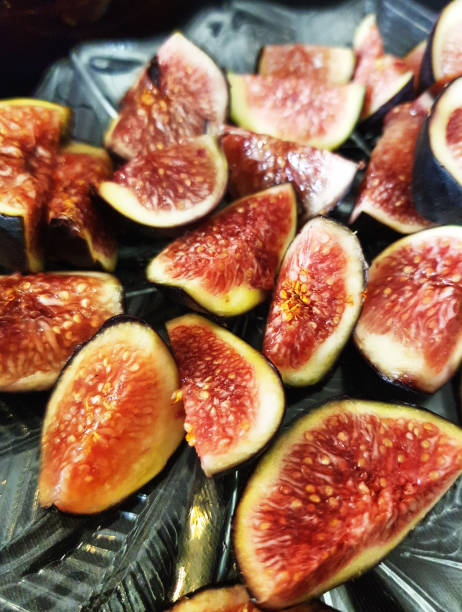 Delicious looking ripe figs sliced open to show juicy interior stock photo
