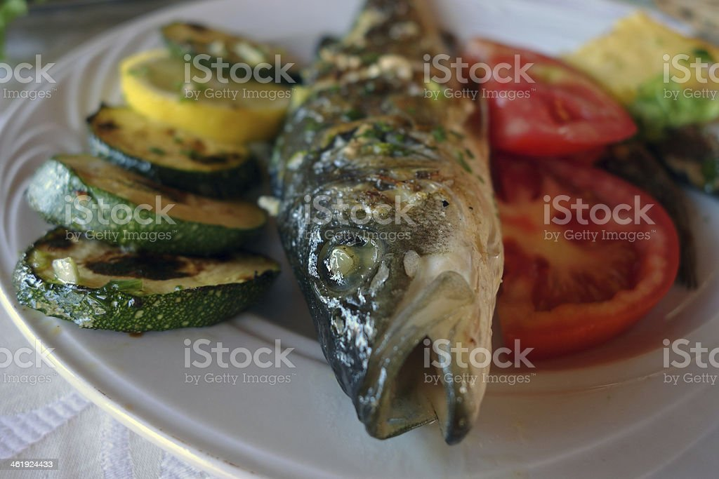 Delicious lunch with fish and vegetables stock photo