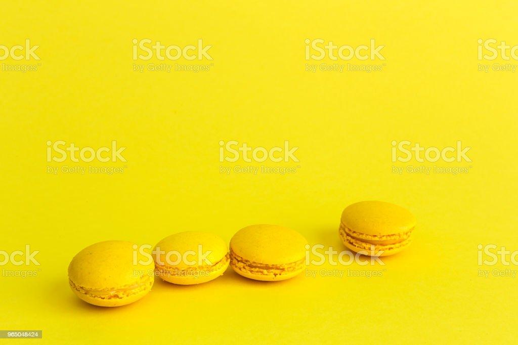 Delicious macaron with yellow background royalty-free stock photo