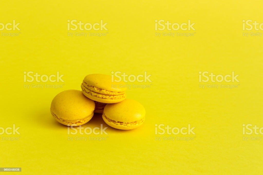 Delicious macaron with yellow background zbiór zdjęć royalty-free