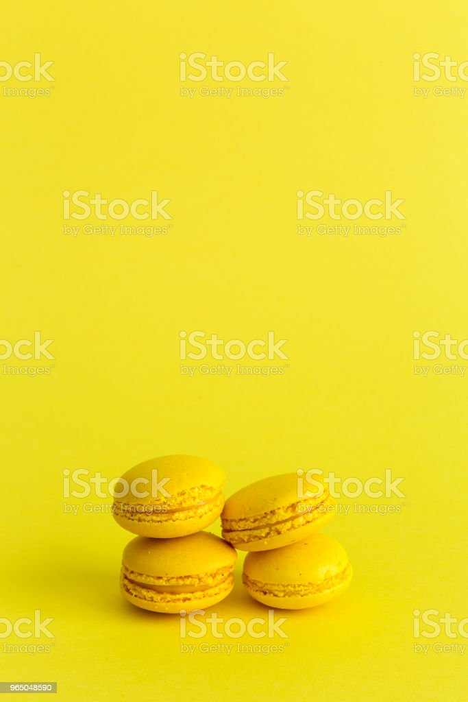 Delicious macaron with yellow background royalty-free stock photo