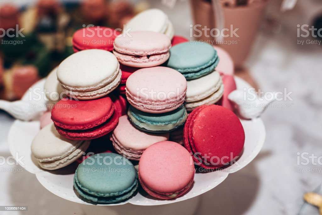 delicious macaroons. candy bar at luxury wedding reception. exclusive expensive catering. table with modern desserts. space for text. baby or bridal shower. holiday celebration stock photo