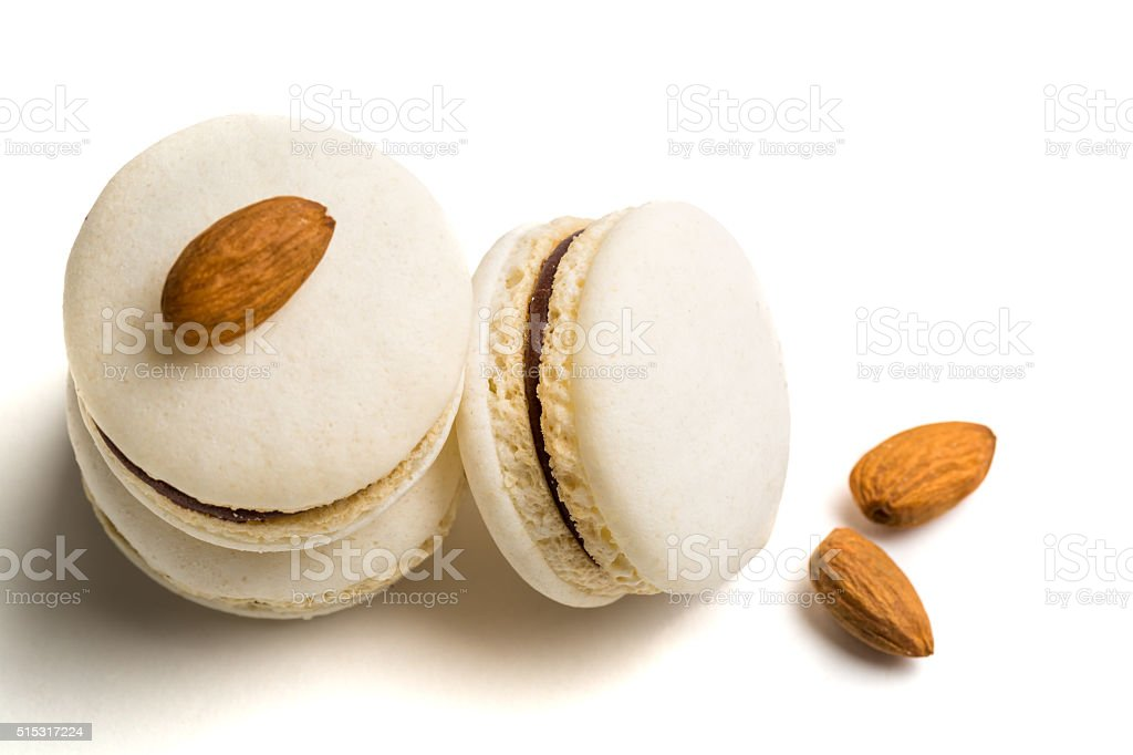Delicious macaroons with almond on white background stock photo