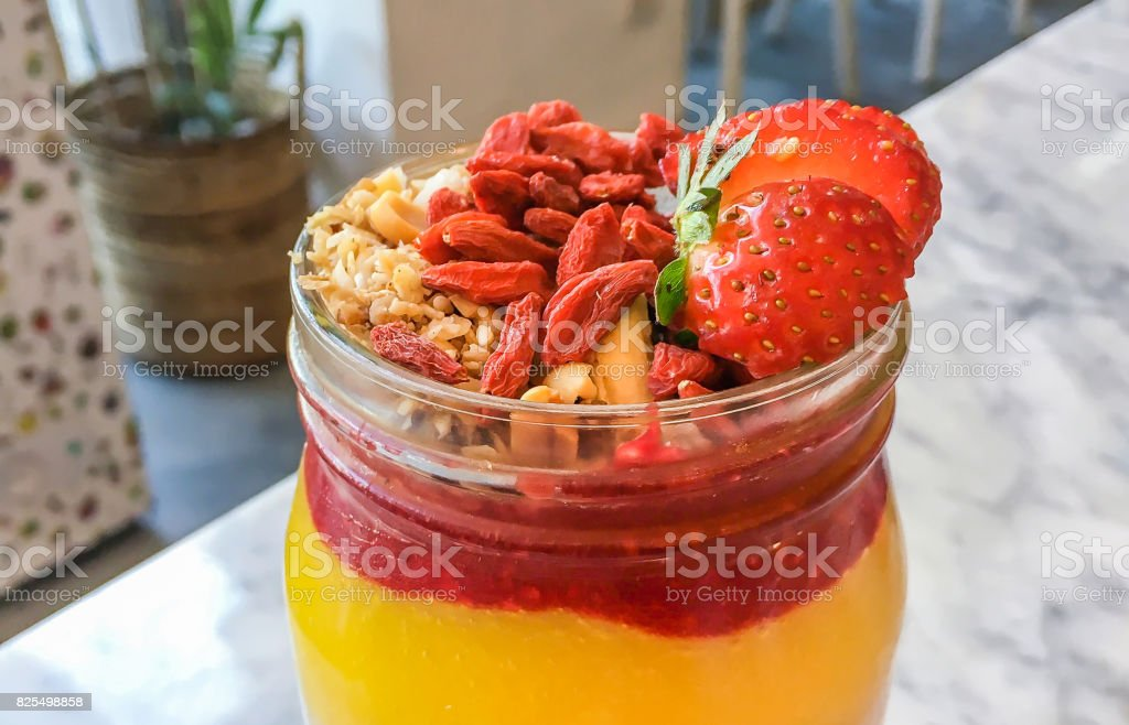 Delicious Mango Smoothies With Goji Berry Seeds And Strawberry