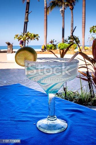 Enjoying a margarita at a sidewalk cafe in Puerto Vallarta, Mexico with a beautiful view of Banderas Bay