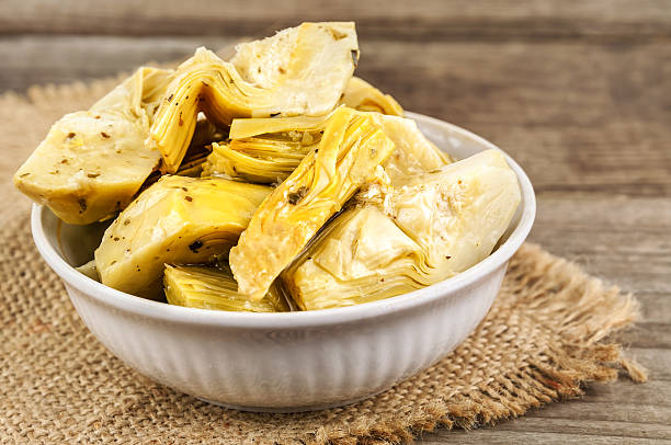 delicious marinated artichoke stock photo