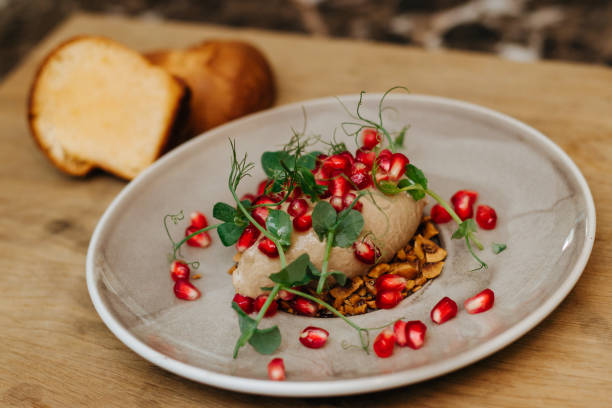 Delicious meal with pomegranate seeds and herbs