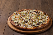 istock Delicious meat pizza on wooden board. Made with Mozzarella, picanha meat, onion, cheese, tomato sauce. Filet Steak, meat. 1240626692