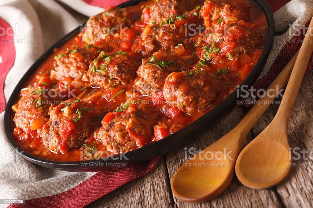 Delicious Meatballs albondigas with spicy sauce on a plate closeup stock photo