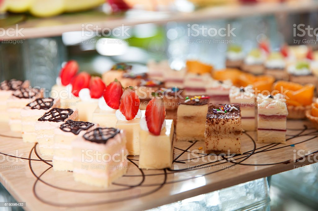 Delicious Mini Cakes on Buffet Table stock photo