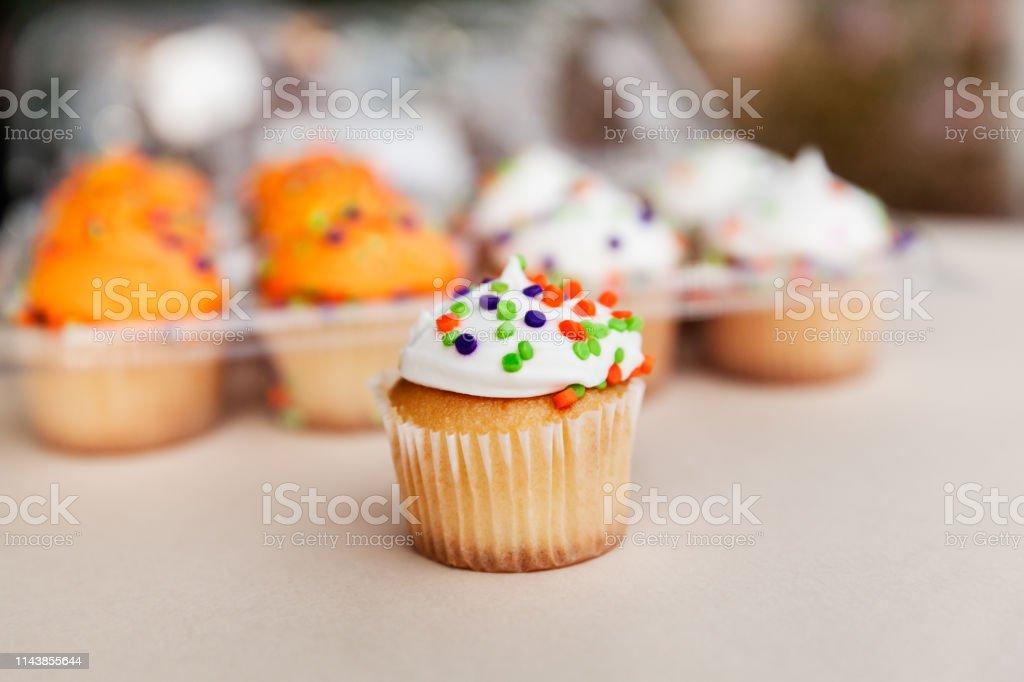 Delicious Mini Cupcake With White Vanilla Cream stock photo
