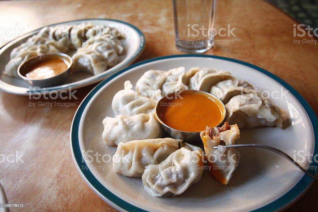 Delicious Mo mo serve with Chutney sauce. stock photo