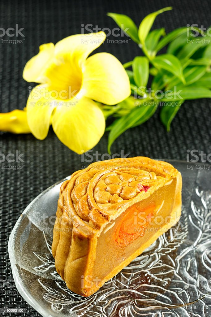 Delicious mooncakes Sliced into pieces on a glass plate. stock photo