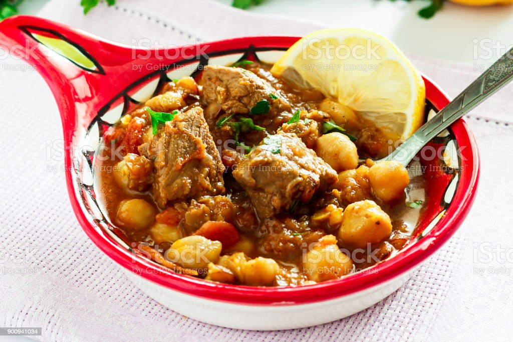 Delicious Moroccan soup harira with meat, chickpeas, lentils, tomatoes and spices. Tradition food for Iftar in holy month of Ramadan. stock photo