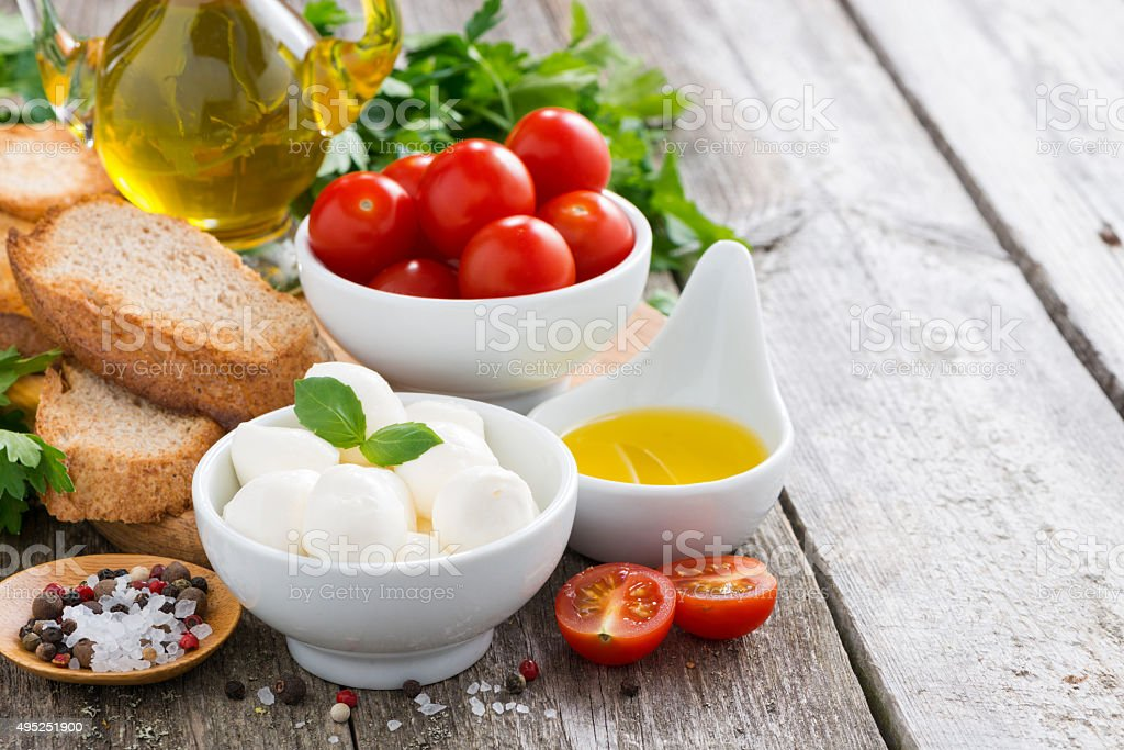 delicious mozzarella and ingredients for the salad stock photo