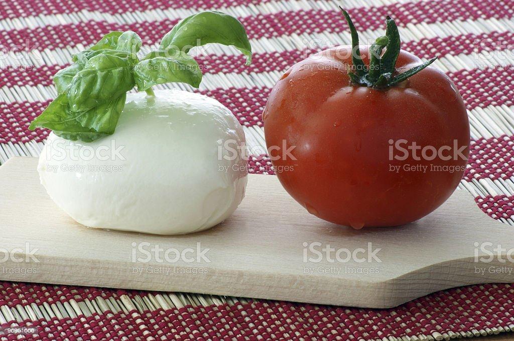 delicious mozzarella with fresh organic tomato and basil royalty-free stock photo