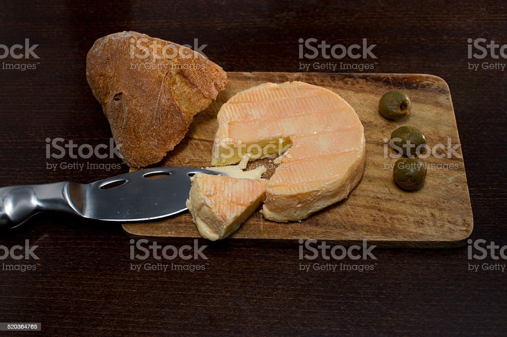 Delicious muenster cheese on wood stock photo
