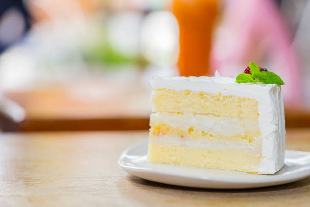 delicious natural coconut cake,selective focus - кусок торта стоковые фото и изображения