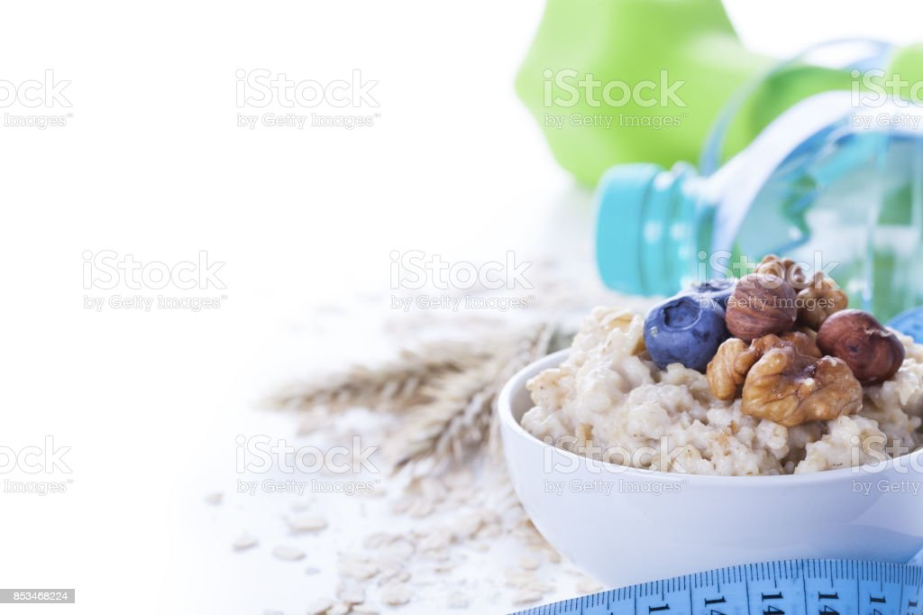 Delicious oatmeal porridge with berries and nuts stock photo