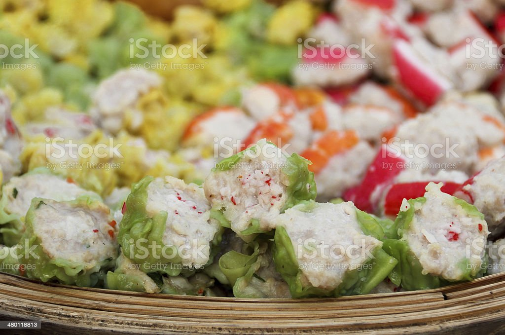 Delicious of steamed food in bamboo plate stock photo
