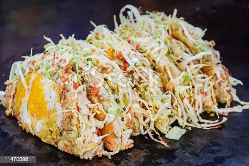Close up shot of fresh okonomiyaki in a row