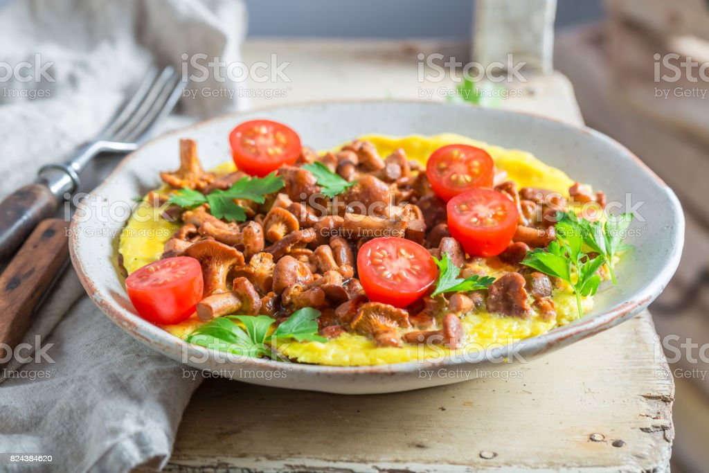 Delicious omelette made of fresh chanterelles mushrooms stock photo