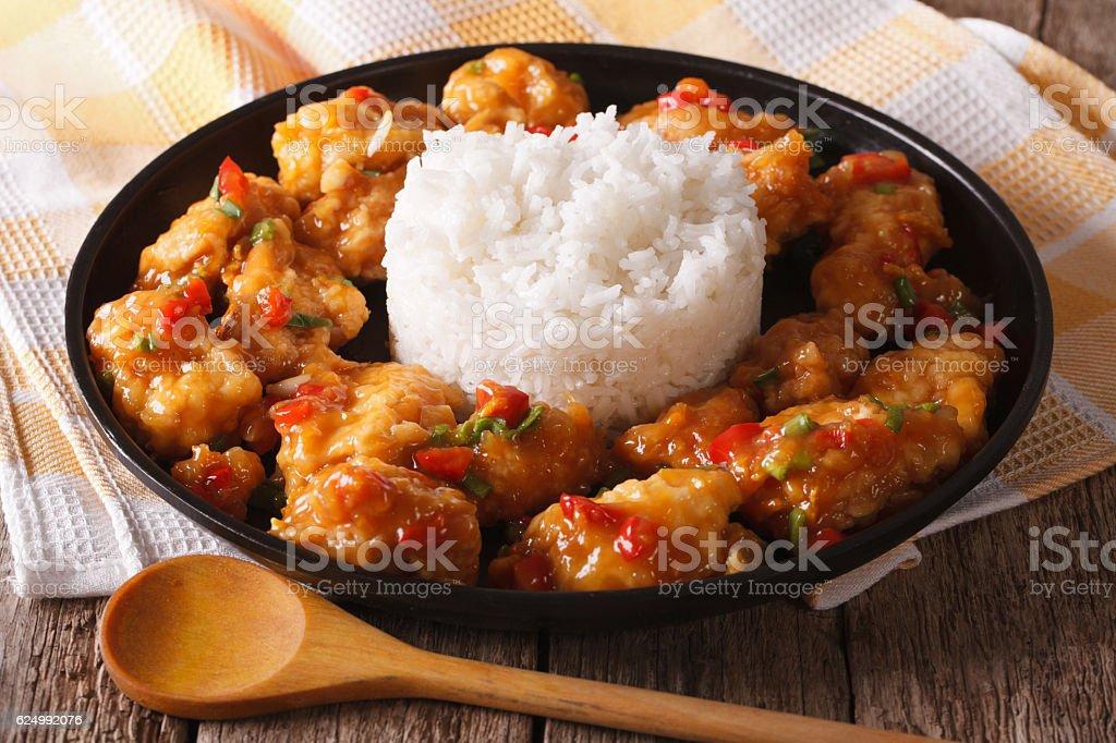 Delicious orange chicken with rice garnish close up. horizontal stock photo