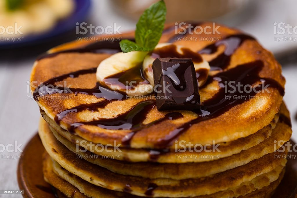 Delicious pancakes with bananas and chocolate. stock photo