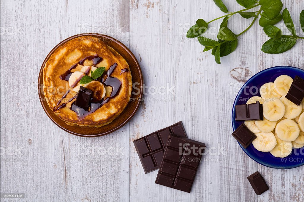 Delicious pancakes with bananas and chocolate. royalty-free stock photo