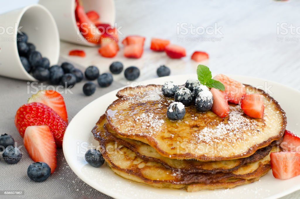 Delicious Pancakes with Strawberries and Blueberries stock photo