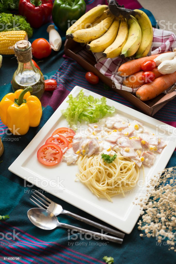 Delicious pasta carbonara with bacon and parmesan in a white plate. homemade food style stock photo