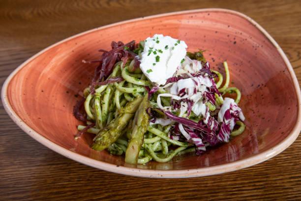 delicious pasta dish. linguine pesto with bresaola, radicchio julienne and ricotta cheese. typical mediterranean cuisine - bresaola foto e immagini stock