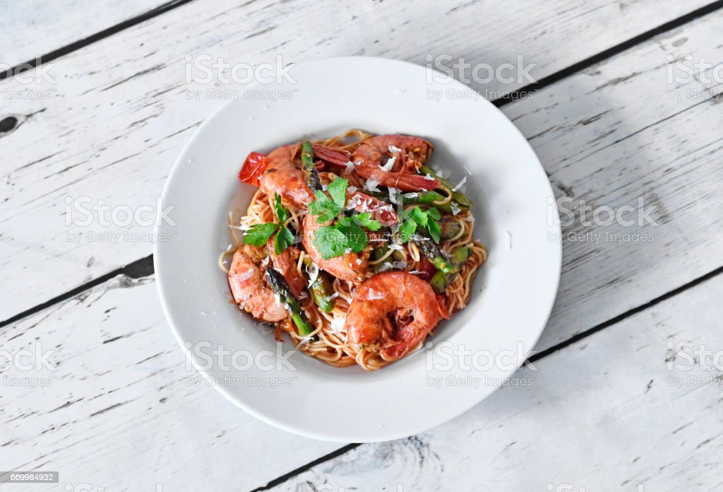 Delicious pasta with great shrimps or prawns and green asparagus stock photo