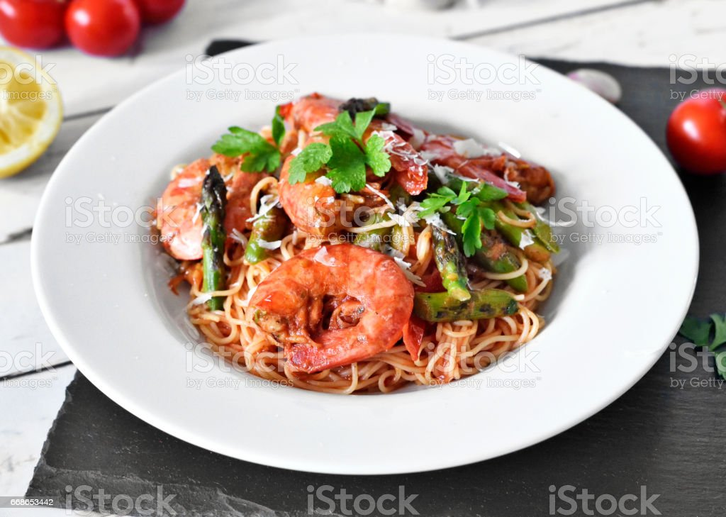 Delicious pasta with great shrimps or prawns stock photo
