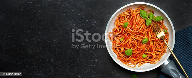 istock Delicious pasta with tomato sauce anf basil 1203557892